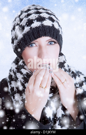 Winter woman in fashionable scarf and hat - Stock Photo