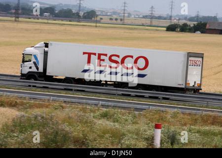 Tesco truck in the landscape - Stock Photo