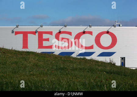TESCO Store, building behind a grass meadow - Stock Photo