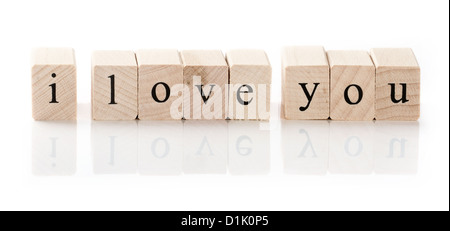 I love you spelled in wooden blocks, isolated on white background - Stock Photo