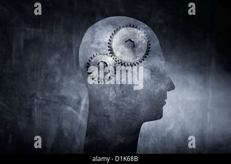 Conceptual image of a head with cog gears as brain. - Stock Photo
