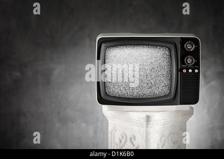 Old portable television with static noise. - Stock Photo