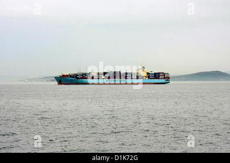 sailing cargo ship,mearsk container ship loaded with containers  in waters - Stock Photo