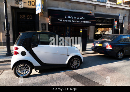 A black and white Smart Car parked outside E. Katz & Co. Ltd Jewellers shop in Hatton Garden London EC1 England - Stock Photo