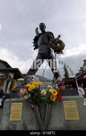 Freddie Mercury statue and memorial with flowers in Montreux, Switzerland - Stock Photo