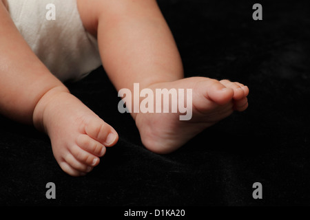 Close up of little baby's feet - Stock Photo