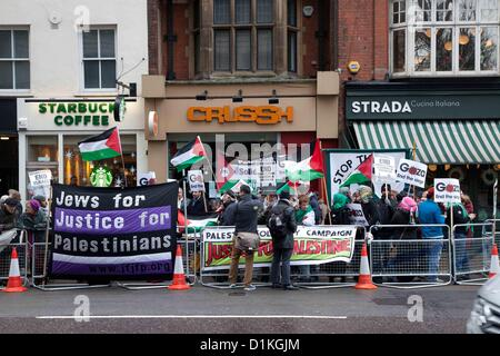 London, UK. 27 December 2012 Palestinians and supporting activists gathered outside The Israeli Embassy to protest - Stock Photo
