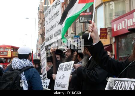 London, UK. 27 December 2012 Hasidic Jews joined the protest outside the Israeli Embassy. - Stock Photo
