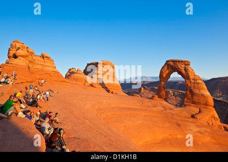 photographers and tourists at Delicate Arch in Arches National Park near Moab Utah USA United states of america - Stock Photo
