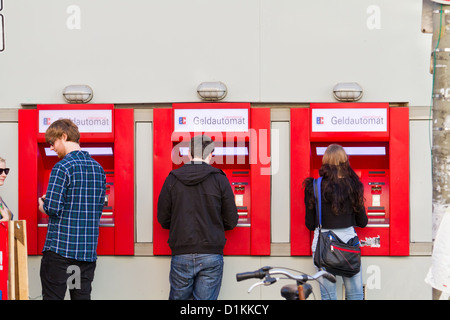 Withdrawing Money from an ATM in the Schanzenviertel in Hamburg, Germany - Stock Photo