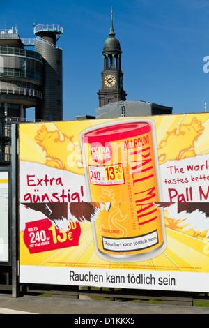 Advertising Poster at the Metro Station Baumwall in Hamburg, Germany - Stock Photo