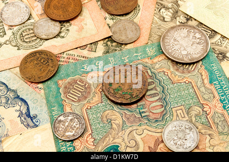 The old banknotes and coins - Stock Photo