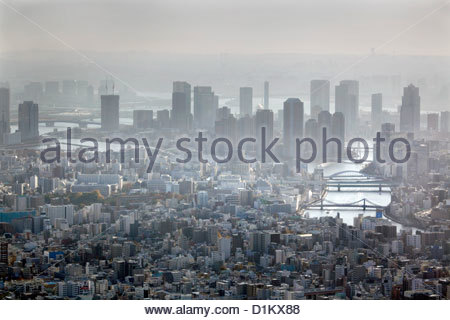 aerial view Tokyo High-rise riverside apartment buildings and Sumida river - Stock Photo