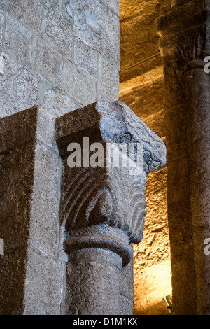 Capital of column in main nave of the Church of St. Salvador in Monastery Leyre, Navarre, Spain. - Stock Photo