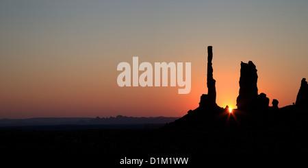 Panoramic photo of Sunrise over Totem Pole, Monument Valley Navajo Tribal Park, Utah, USA - Stock Photo
