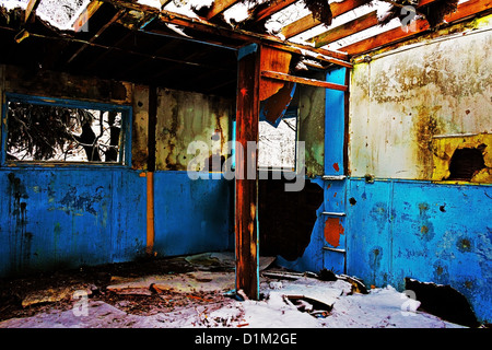 A view of old ruined camp house, colors changed and saturated. - Stock Photo