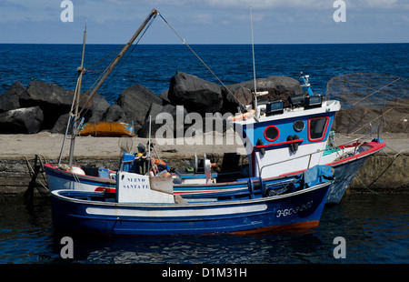 Fishing boats in small harbour at La Santa lanzarote Canary Islands - Stock Photo
