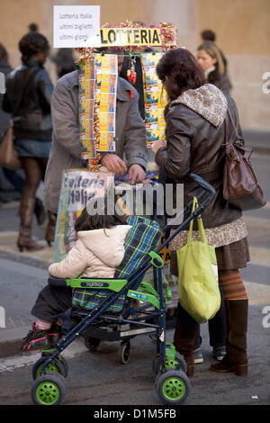 28th December 2012, Rome Italy. A man selling lottery tickets during  post Christmas sales with shoppers out for - Stock Photo