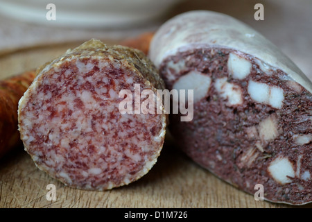 Different varieties of sausage to eat on a table - Stock Photo