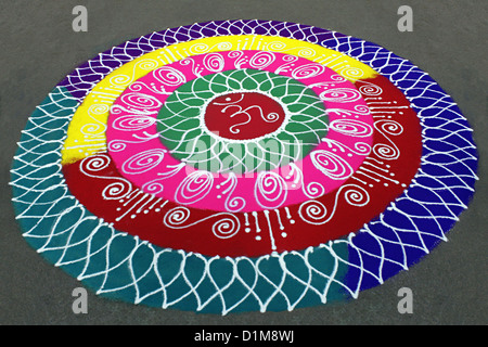 Colorful rangoli, circular designs on the floor during  ganesh festival in Pune, Maharashtra, india - Stock Photo