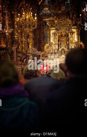 Pilgrim Mass, Santiago Cathedral, St. James statue in the background overlooking the ceremony the final stage of - Stock Photo