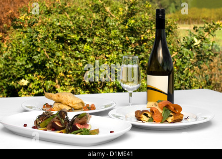 Three delicious luncheon dishes, complete with a bottle of quality Chardonnay - Stock Photo