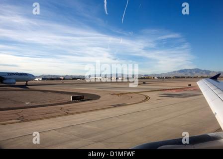 aircraft on runway and taxiway waiting to take off at McCarran International airport Las Vegas Nevada USA - Stock Photo