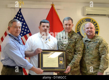 (Left to right) Retired U.S. Army Lt. Gen. R. Steven Whitcomb, Jeffrey Creaser, a food service manager in Afghanistan, - Stock Photo