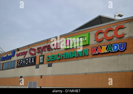 Advertisements on the wall of Carrefour supermarket, brands logos, ads - Stock Photo