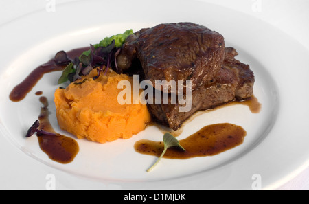 Pasture-fed Sirloin Steak, with Sweet Potato Mash, Pea Puree, and a Red Wine Jus - Stock Photo