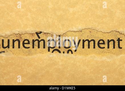 Unemployment text on grunge paper - Stock Photo