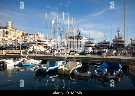 A view of Monte Carlo, Monaco, captured from the marina, filled with boats of all sizes and monetary worth - Stock Photo