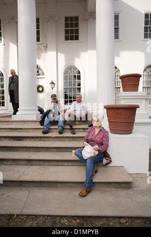 Tour Group on the front steps of Plum Orchard Mansion - Stock Photo