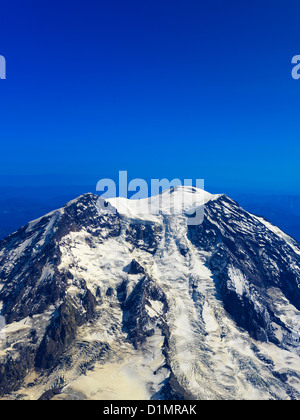 Mount Rainier an aerial photo of this large active volcano and the caldera on top of the large mountain just east - Stock Photo