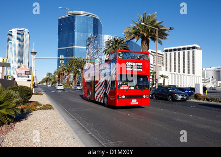 the hop on hop off red open top double deck bus on the Las Vegas strip Nevada USA - Stock Photo