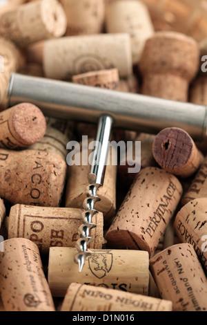 Wine corks an corkscrew - Stock Photo