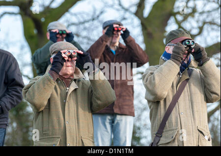 Spectators watch the racing the Cambridgeshire Harriers Hunt Club Point-to-Point Races at Cottenham, Cambridgeshire - Stock Photo