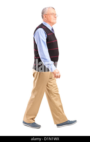 Full length portrait of a senior man walking isolated on white background - Stock Photo