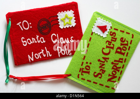 letter felt Christmas decorations addressed to Santa Claus North Pole post dated 24 Dec set on white background - Stock Photo