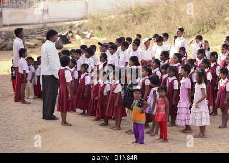 Indian school teacher with children Andhra Pradesh South India - Stock Photo