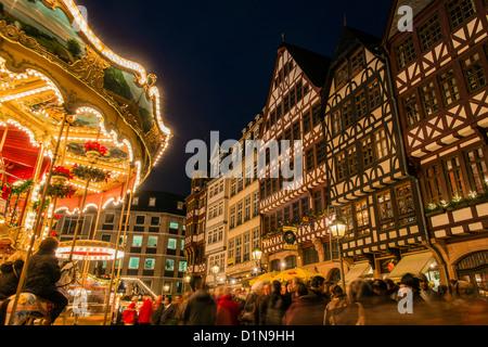 Night view of the Romer, Römerberg, with merry-go-round lights, Frankfurt am Main, Hesse, Germany - Stock Photo