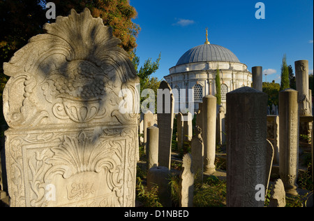 Carving on grave stones and Mausoleum in the Ottoman cemetery at Eyup Sultan Mosque Istanbul Turkey - Stock Photo