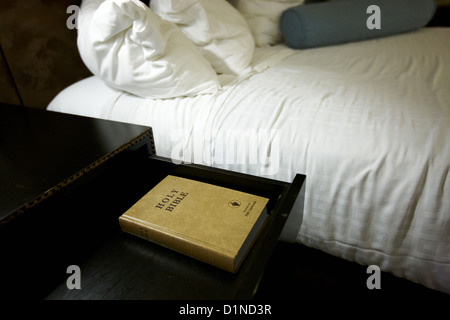 holy bible left by the gideons in a drawer at the side of the bed in a hotel room in Las Vegas Nevada USA - Stock Photo