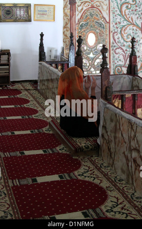 Praying Woman in the Et'hem Bey Mosque in Tirana - Stock Photo