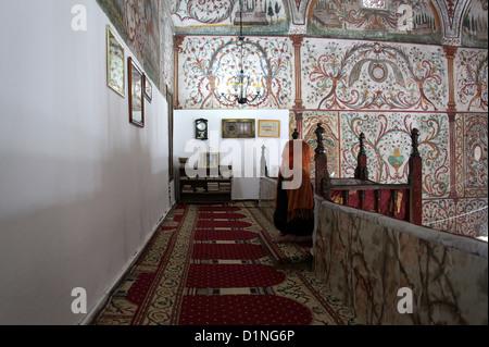 Woman Praying inside the Et'hem Bey Mosque in Tirana - Stock Photo