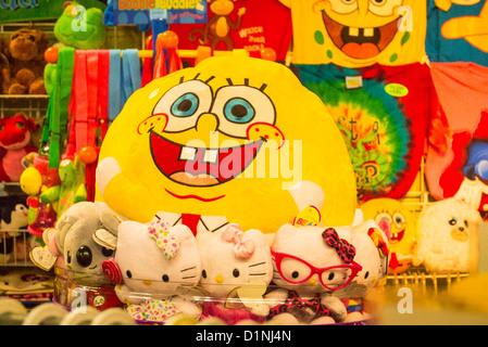 USA Florida Boca Raton Festival Flea Market Mall colourful colorful inflatable toys Hello Kitty dolls smiling faces - Stock Photo