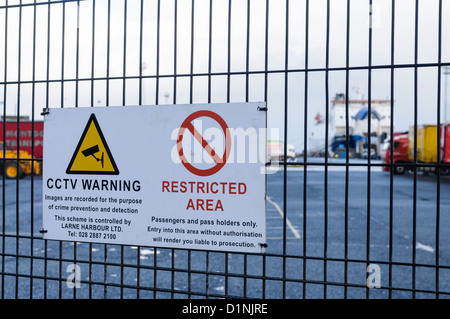 Sign at the Port of Larne ferry terminal and harbour, warning that this is a restricted area and that CCTV is in - Stock Photo