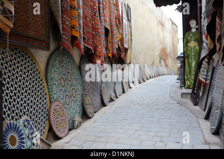 Traditional ceramics and carpets on sale in Fez, Morocco - Stock Photo