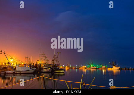 Rockport-Fulton marina with commercial fishing boats at night, Gulf of Mexico, Texas, USA - Stock Photo