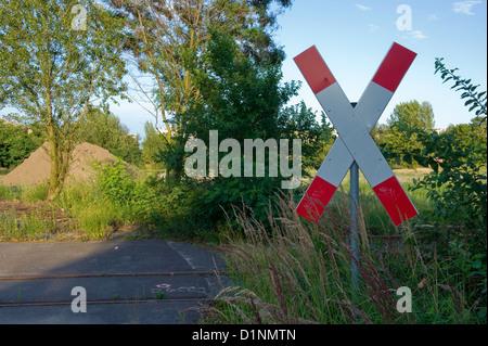 Berlin, Germany, and St. Andrew's cross on the tracks Gleisdreiecksgelaende - Stock Photo